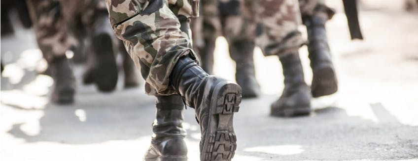 running-soldiers-carrying-weapons-picture-id475000807.jpg